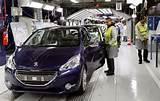 travail à la chaîne à Peugeot Poissy